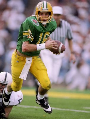 2 Jan 1995:  Quarterback Danny O''Neil of the Oregon Ducks tries to break a tackle during the Rose Bowl against the Penn State Nittany Lions at the Rose Bowl in Pasadena, California.  Penn State won the game 38-20. Mandatory Credit: Mike Powell  /Allsport