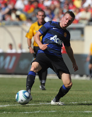 CHICAGO, IL - JULY 23: Tom Cleverly #35 of Manchester United passes the ball against the Chicago Fire in a friendly match during the World Football Challenge 2011 at Soldier Field on July 23, 2011 in Chicago, Illinois. Manchester United defeated the Fire