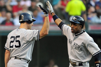 CLEVELAND, OH - JULY 5: Mark Teixeira #25 celebrates with Curtis Granderson #14 of the New York Yankees after Granderson's second home run of the night during the third inning against the Cleveland Indians at Progressive Field on July 5, 2011 in Cleveland