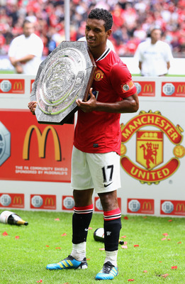 LONDON, ENGLAND - AUGUST 07:  Nani of Manchester United poses with the Community Shield after victory in the FA Community Shield match sponsored by McDonald's between Manchester City and Manchester United at Wembley Stadium on August 7, 2011 in London, En