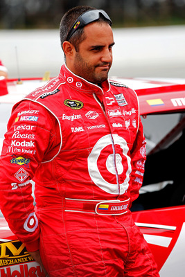 LONG POND, PA - AUGUST 06: Juan Pablo Montoya, driver of the #42 Target Chevrolet, stands next to his car on the grid during qualifying for the NASCAR Sprint Cup Series Good Sam RV Insurance 500 at Pocono Raceway on August 6, 2011 in Long Pond, Pennsylvan