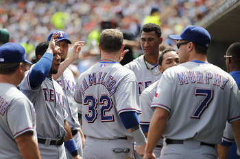 DETROIT - AUGUST 04: Josh Hamilton #32 of the Texas Rangers celebrates with his teammates aftering scoring on a triple from Michael Young #10 in the seventh inning during the game at Comerica Park on August 4, 2011 in Detroit, Michigan. The Rangers defeat