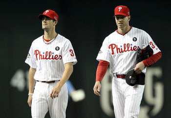 PHOENIX, AZ - JULY 12:  National League All-Star Cole Hamels #35 of the Philadelphia Phillies and National League All-Star Roy Halladay #34 of the Philadelphia Phillies look on during batting practice before the start of the 82nd MLB All-Star Game at Chas