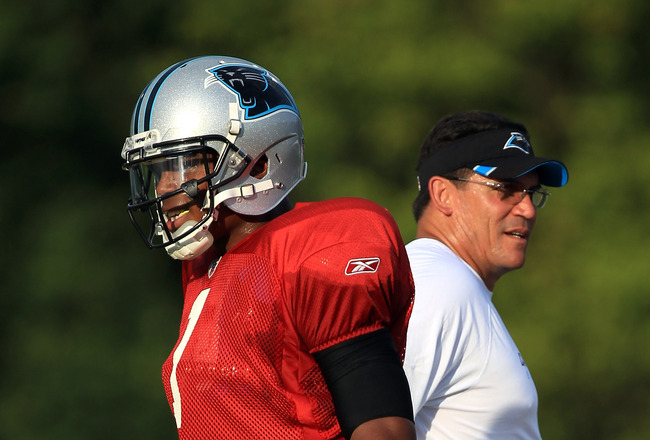 SPARTANBURG, SC - AUGUST 03:  Cam Newton #1 of the Carolina Panthers stands next to head coach Ron Rivera during training camp at Wofford College on August 3, 2011 in Spartanburg, South Carolina.  (Photo by Streeter Lecka/Getty Images)
