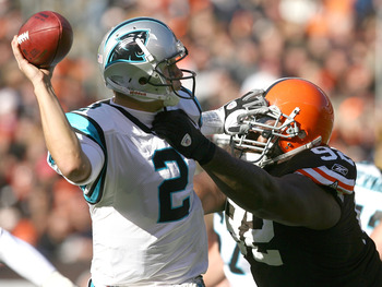 CLEVELAND - NOVEMBER 28:  Quarterback Jimmy Clausen #2 of the Carolina Panthers is hit by defensive lineman Shaun Rogers #92 of the Cleveland Browns at Cleveland Browns Stadium on November 28, 2010 in Cleveland, Ohio.  (Photo by Matt Sullivan/Getty Images