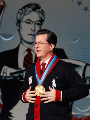 VANCOUVER, BC - FEBRUARY 18:  Comedian and talk show host Stephen Colbert reacts after putting on the Olympic gold medal won by United States Snowboard Cross athlete Seth Westcott while taping an episode of The Colbert Report at Creekside Park on February