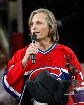 MONTREAL- DECEMBER 4:  Actor Viggo Mortensen introduces former Montreal Canadien Guy Lafleur to fans during the Centennial Celebration ceremonies prior to the NHL game between the Montreal Canadiens and Boston Bruins on December 4, 2009 at the Bell Centre