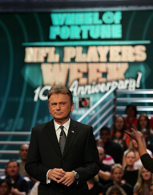 FORT LAUDERDALE, FL - DECEMBER 06: Host Pat Sajak performs during the NFL Players Week 10th Anniversary on Wheel Of Fortune on December 6, 2005 in Fort Lauderdale, Florida. (Photo by Doug Benc/Getty Images for PLAYERS INC)