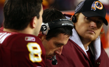 LANDOVER, MD - JANUARY 02:  Offensive coordinator Kyle Shanahan (C) of the Washington Redskins works on the sideline with quarterbacks Rex Grossman #8 and John Beck #3 in the fourth quarter of a game against the New York Giants at FedEx Field on January 2