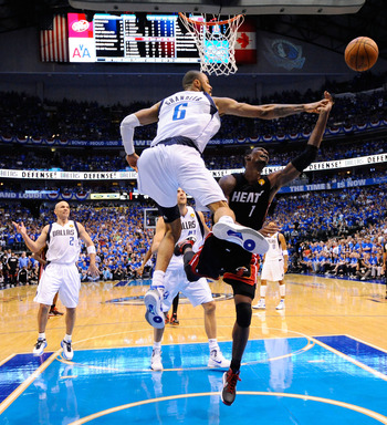 DALLAS, TX - JUNE 09:  Chris Bosh #1 of the Miami Heat drives for a shot attempt against Tyson Chandler #6 of the Dallas Mavericks in Game Five of the 2011 NBA Finals at American Airlines Center on June 9, 2011 in Dallas, Texas.  NOTE TO USER: User expres