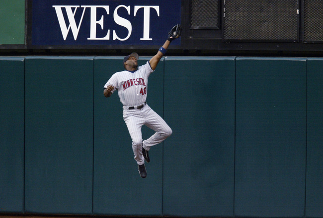 ANAHEIM, CA - OCTOBER 11:  Torii Hunter #48 of the Minnesota Twins makes a leaping catch at the wall during Game three of the American League Championship Series against the Anaheim Angels at Edison International Field on October 11, 2002 in Anaheim, Cali