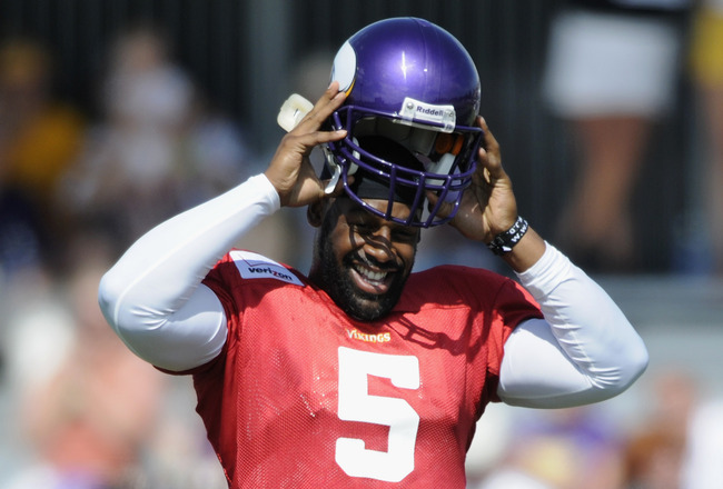 MANKATO, MN - AUGUST 4:  Donovan McNabb #5 of the Minnesota Vikings smiles as he puts on his helmet soon after the NFLPA ratified the new CBA during Vikings' training camp at Minnesota State University on August 4, 2011 in Mankato, Minnesota. (Photo by Ha