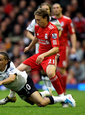 LIVERPOOL, ENGLAND - MAY 15:  Steven Pienaar of Spurs is brought down by Lucas of Liverpool during the Barclays Premier League match between Liverpool and Tottenham Hotspur at Anfield on May 15, 2011 in Liverpool, England.  (Photo by Michael Steele/Getty