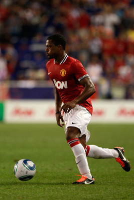 HARRISON, NJ - JULY 27:  Patrice Evra #3 of the Manchester United moves the ball against the MLS All-Stars during the second half of the MLS All-Star Game at Red Bull Arena on July 27, 2011 in Harrison, New Jersey.  (Photo by Chris Trotman/Getty Images)
