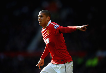 MANCHESTER, ENGLAND - MARCH 19: Chris Smalling of Manchester United looks on during the Barclays Premier League match between Manchester United and Bolton Wanderers at Old Trafford on March 19, 2011 in Manchester, England.  (Photo by Laurence Griffiths/Ge