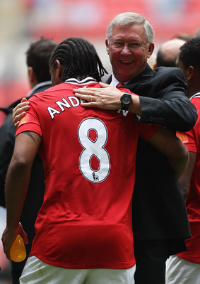 LONDON, ENGLAND - AUGUST 07:  Manchester United manager Sir Alex Ferguson celebrates with Anderson after victory in the FA Community Shield match sponsored by McDonald's between Manchester City and Manchester United at Wembley Stadium on August 7, 2011 in