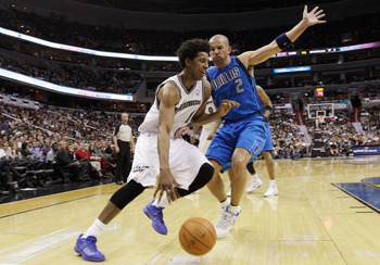 WASHINGTON, DC - FEBRUARY 26: Nick Young #1 of the Washington Wizards drives around Jason Kidd #2 of the Dallas Mavericks at the Verizon Center on February 26, 2011 in Washington, DC. NOTE TO USER: User expressly acknowledges and agrees that, by downloadi