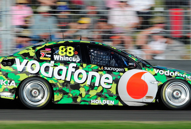 TOWNSVILLE, AUSTRALIA - JULY 10:  Jamie Whincup drives the #88 Team Vodafone Holden during race 15 for round seven of the V8 Supercar Championship Series at Reid Park on July 10, 2011 in Townsville, Australia.  (Photo by Ian Hitchcock/Getty Images)
