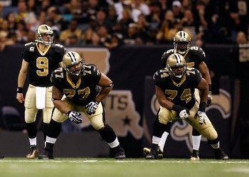 NEW ORLEANS - JANUARY 16:  (L-R) Offensive lineman Carl Nicks #77 and Jermon Bushrod #74 of the New Orleans Saints get set to pass protect as Drew Brees #9 and Reggie Bush #25 await the snap against the Arizona Cardinals during the NFC Divisional Playoff
