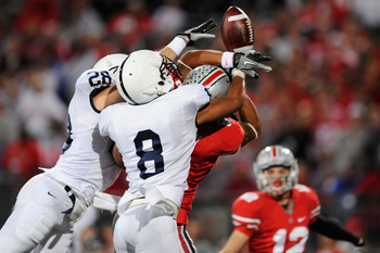 COLUMBUS, OH - NOVEMBER 13:  Drew Astorino #28 and D'Anton Lynn #8, both of the Penn State Nittany Lions, break up a pass intended for DeVier Posey #8 of the Ohio State Buckeyes as Dane Sanzenbacher #12 of the Ohio State Buckeyes waits nearby to make the