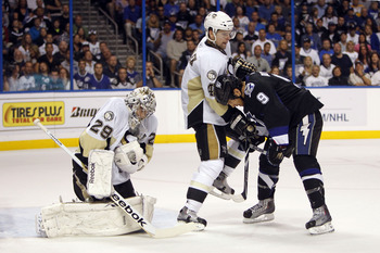 TAMPA, FL - APRIL 25: Goaltender Mark-Andre Fleury #29 of the Pittsburgh Penguins defends the net with the help of teammate Zbynek Michalek #4 against Steve Downie #9 of the Tampa Bay Lightning in Game Six of the Eastern Conference Quarterfinals during th