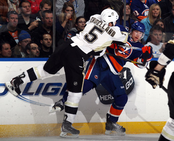 UNIONDALE, NY - APRIL 08: Josh Bailey #12 of the New York Islanders is hit by Deryk Engelland #5 of the Pittsburgh Penguins at the Nassau Coliseum on April 8, 2011 in Uniondale, New York.  (Photo by Bruce Bennett/Getty Images)