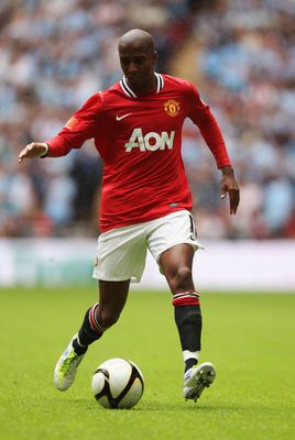 LONDON, ENGLAND - AUGUST 07:  Ashley Young of Manchester United runs with the ball during the FA Community Shield match sponsored by McDonald's between Manchester City and Manchester United at Wembley Stadium on August 7, 2011 in London, England.  (Photo