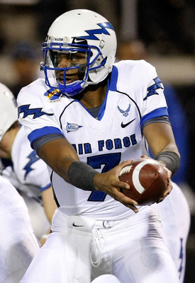LAS VEGAS - NOVEMBER 18:  Quarterback Tim Jefferson Jr. #7 of the Air Force Falcons hands the ball off during a game against the UNLV Rebels at Sam Boyd Stadium November 18, 2010 in Las Vegas, Nevada. Air Force won 35-20.  (Photo by Ethan Miller/Getty Ima