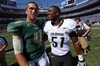 DENVER - SEPTEMBER 04:  Quarterback Pete Thomas #4 of the Colorado State Rams and linebacker Douglas Rippy #51 of the Colorado Buffaloes chat after the the Rocky Mountain Showdown at INVESCO Field at Mile High on September 4, 2010 in Denver, Colorado. Col
