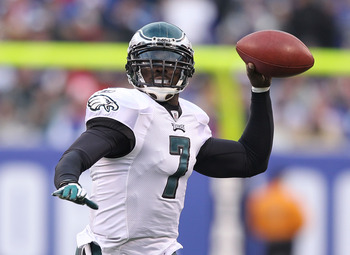 EAST RUTHERFORD, NJ - DECEMBER 19:  Michael Vick #7 of the Philadelphia Eagles looks to pass against the New York Giants during their game on December 19, 2010 at The New Meadowlands Stadium in East Rutherford, New Jersey.  (Photo by Al Bello/Getty Images