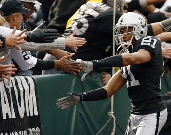 Oakland cornerback Nnamdi Asomugha welcomed by the crowd in the Black Hole as the Denver Broncos defeated the Oakland Raiders by a score of 17 to 13 at McAfee Coliseum, Oakland, California, November 12, 2006. (Photo by Robert B. Stanton/NFLPhotoLibrary)