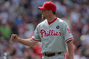 DENVER, CO - AUGUST 03:  Closer Brad Lidge #54 of the Philadelphia Phillies celebrates after the final out as the Phillies defeat the Colorado Rockies at Coors Field on August 3, 2011 in Denver, Colorado. Lidge earned his first save of the season as the P