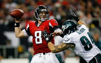 ATLANTA - DECEMBER 06:  Quarterback Chris Redman #8 of the Atlanta Falcons against Jason Babin #94 of the Philadelphia Eagles at Georgia Dome on December 6, 2009 in Atlanta, Georgia.  (Photo by Kevin C. Cox/Getty Images)