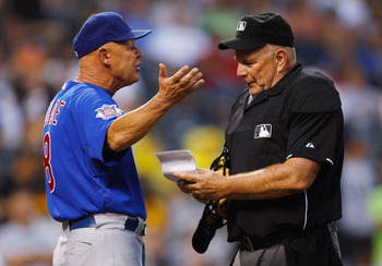 PITTSBURGH - AUGUST 03:  Mike Quade #8 of the Chicago Cubs argues with home plate umpire Bob Davidson after being thrown out during the game against the Pittsburgh Pirates on August 3, 2011 at PNC Park in Pittsburgh, Pennsylvania.  (Photo by Jared Wickerh