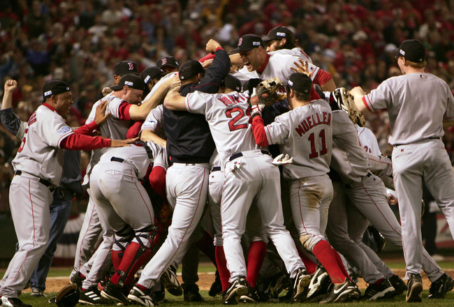 ST LOUIS - OCTOBER 27:   The Boston Red Sox celebrate on the field after defeating the St. Louis Cardinals 3-0 in game four of the World Series on October 27, 2004 at Busch Stadium in St. Louis, Missouri. (Photo by Jed Jacobsohn/Getty Images)