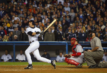 BRONX, NY - OCTOBER 16:  Aaron Boone #19 of the New York Yankees hits the game winning home run in the bottom of the eleventh inning against the Boston Red Sox during game 7 of the American League Championship Series on October 16, 2003 at Yankee Stadium