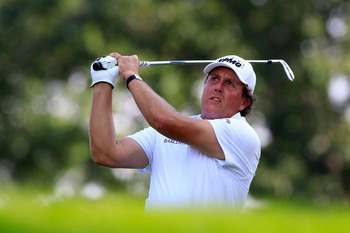 AKRON, OH - AUGUST 05:  Phil Mickelson hits a tee shot on the 15th hole during the second round of the World Golf Championships-Bridgestone Invitational on the South Course at Firestone Country Club on August 5, 2011 in Akron, Ohio.  (Photo by Sam Greenwo