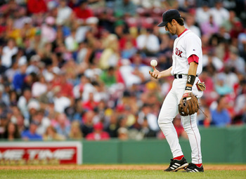 BOSTON - JULY 24:  Nomar Garciaparra #5 of the Boston Red Sox looks down after making an error on a ball hit by Bernie Williams #51 of the New York Yankees in the seventh inning on July 24, 2004 at Fenway Park in Boston, Massachusetts.  (Photo by Ezra Sha