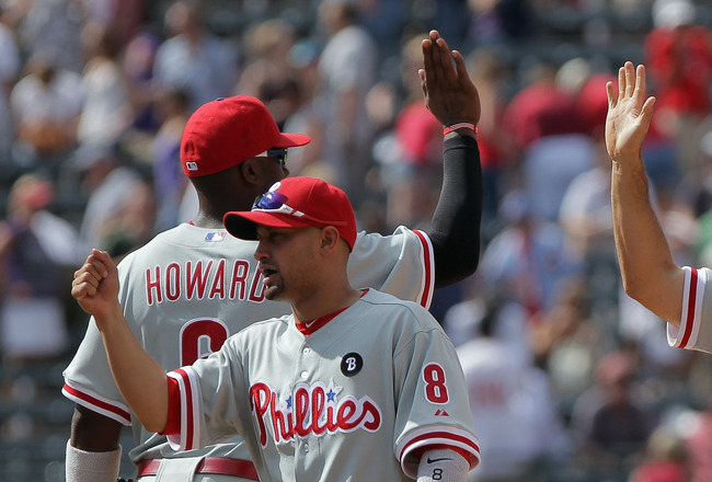 DENVER, CO - AUGUST 03:  The Philadelphia Phillies celebrate their 8-6 win over the Colorado Rockies at Coors Field on August 3, 2011 in Denver, Colorado.  (Photo by Doug Pensinger/Getty Images)