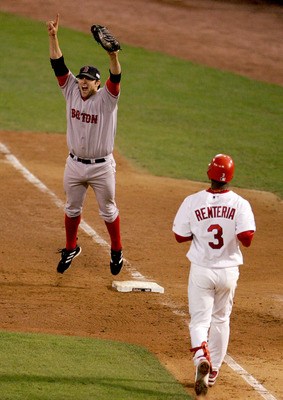 ST LOUIS - OCTOBER 27:  Doug Mientkiewicz #13 of the Boston Red Sox celebrates the final out and defeating the St. Louis Cardinals 3-0 in game four of the World Series on October 27, 2004 at Busch Stadium in St. Louis, Missouri. (Photo by Al Bello/Getty I
