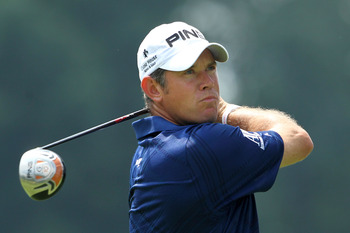 AKRON, OH - AUGUST 07:   Lee Westwood of England hits his tee shot on the third hole during the final round of the World Golf Championships-Bridgestone Invitational on the South Course at Firestone Country Club on August 7, 2011 in Akron, Ohio.  (Photo by