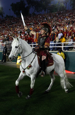 PASADENA, CA - JANUARY 01:  USC Trojans Hector Aguilar trots horse Traveler on the sideline during the Rose Bowl presented by Citi between the USC Trojans and the Illinois Fighting Illini at the Rose Bowl on January 1, 2008 in Pasadena, California.  The T