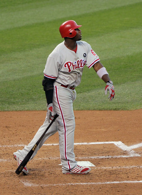 DENVER, CO - AUGUST 02:  Ryan Howard #6 of the Philadelphia Phillies watches his solo homerun off of starting pitcher Aaron Cook #28 of the Colorado Rockies to give the Phillies a 3-0 lead in the fourth inning at Coors Field on August 2, 2011 in Denver, C