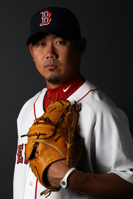 FT. MYERS, FL - FEBRUARY 20:  Daisuke Matsuzaka #18 of the Boston Red Sox poses for a portrait during the Boston Red Sox Photo Day on February 20, 2011 at the Boston Red Sox Player Development Complex in Ft. Myers, Florida  (Photo by Elsa/Getty Images)