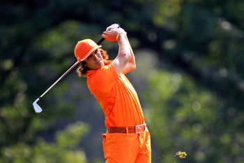 AKRON, OH - AUGUST 07:  Rickie Fowler hits his second shot on the 16th hole during the final round of the World Golf Championships-Bridgestone Invitational on the South Course at Firestone Country Club on August 7, 2011 in Akron, Ohio.  (Photo by Sam Gree