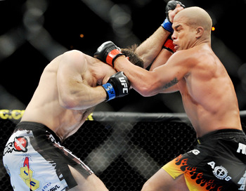 LAS VEGAS - NOVEMBER 21: Tito Ortiz (R) battles Forrest Griffin (L) during their Light Heavyweight Fight at the UFC 106 at Mandalay Bay Events Center on November 21, 2009 in Las Vegas, Nevada. (Photo by Jon Kopaloff/Getty Images)