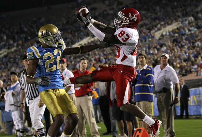PASADENA, CA - SEPTEMBER 18:  Wide receiver Patrick Edwards #83 of the Houston Cougars goes up for the balll against cornerback Sheldon Price #22 of the UCLA Bruins at the Rose Bowl on September 18, 2010 in Pasadena, California.  UCLA won 31-13.  (Photo b