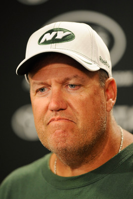 FLORHAM PARK, NJ - AUGUST 07:  Head coach Rex Ryan speaks to members of the media after the morning walk through at NY Jets Practice Facility on August 7, 2011 in Florham Park, New Jersey.  (Photo by Patrick McDermott/Getty Images)