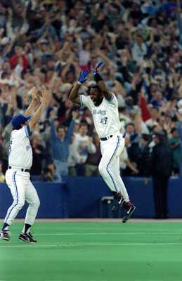 23 Oct 1993: Joe Carter of the Toronto Blue Jays celebrates his 9th inning, 3 run homerun to defeat the Philadelphia Phillies 8-6 to win the 1993 World Series at the Skydome in Toronto, Canada.