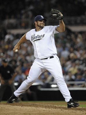 SAN DIEGO, CA - AUGUST 3:  Heath Bell #21 of the San Diego Padres pitches during the ninth inning of a baseball game against the Los Angeles Dodgers at Petco Park on August 3, 2011 in San Diego, California.  The Padres won 3-0. (Photo by Denis Poroy/Getty